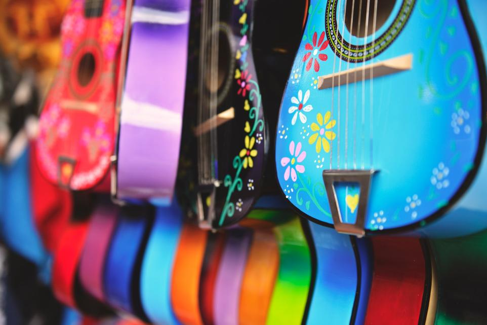 assorted-color guitars